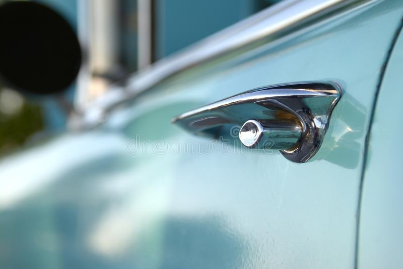 Closeup Shallow Focus Door Handle Lock 1950s Classic Muscle Car royalty free stock image