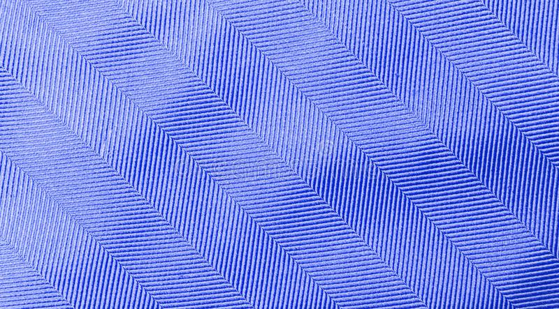 Closeup shiny waving blue fabric pattern background royalty free stock photography