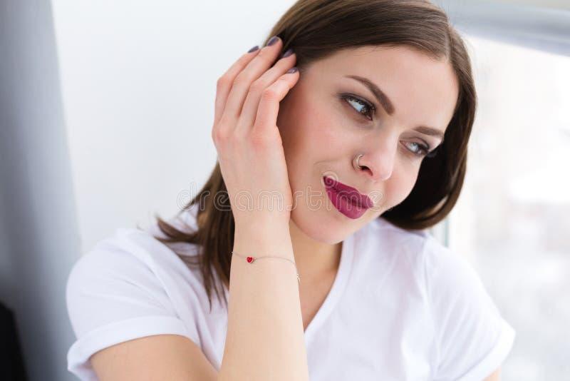 Beautiful stylish woman wearing red hearth bracelet stock photos