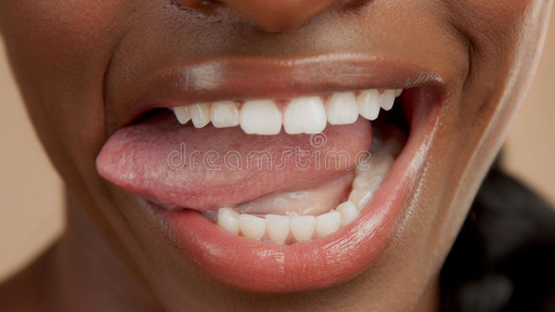 Closeup of mouth of black mixed race woman royalty free stock photography