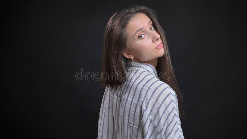 Closeup shoot of young attractive caucasian female fashion model posing from the back view with isolated background royalty free stock images