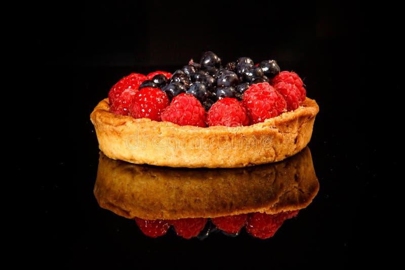 closeup shortbread mini tart with raspberries and blueberries royalty free stock photos