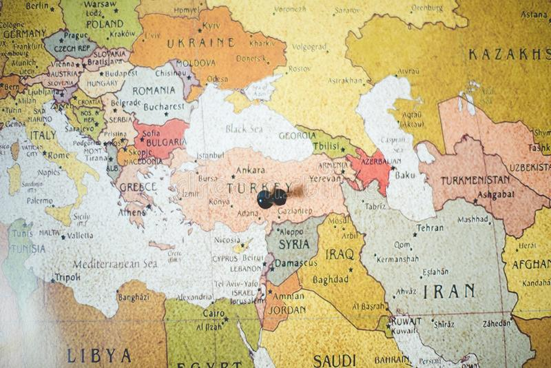 Closeup shot of a black pin on the turkey country on a map. A closeup shot of a black pin on the turkey country on a map royalty free stock image