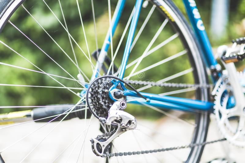 Closeup shot of blue bicycle gears with a blurred background. A closeup shot of blue bicycle gears with a blurred background royalty free stock photo