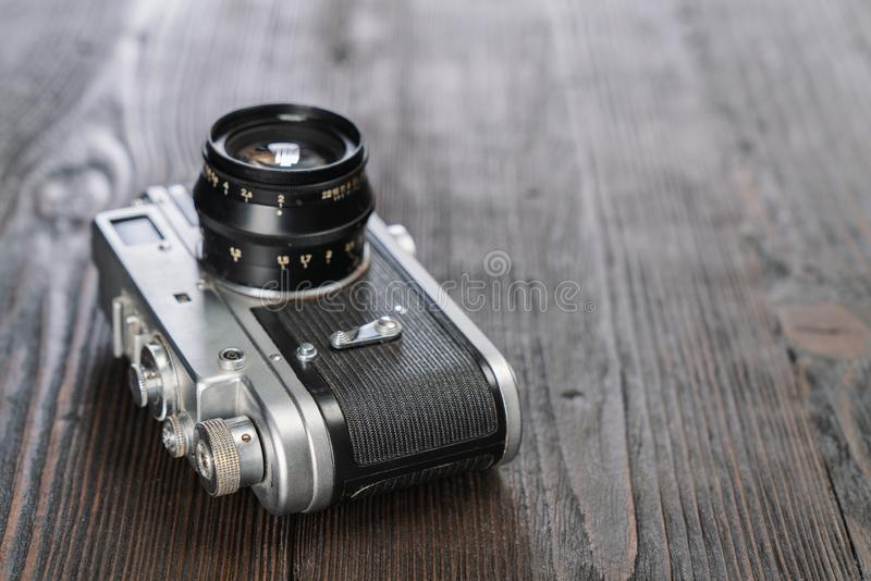 Closeup shot of a camera on a grungy wooden background stock images