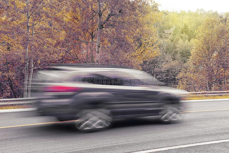 SUV car in motion during fall season. Closeup shot of a car in motion during fall season royalty free stock photography