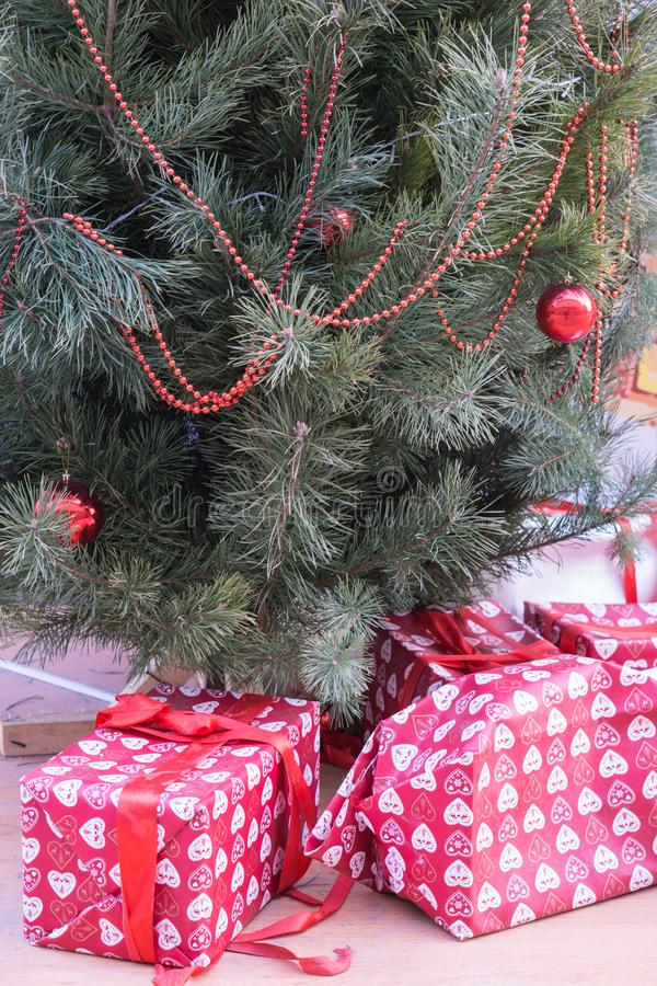 Closeup shot of christmas tree with presents royalty free stock photography
