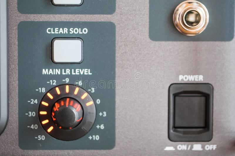 Closeup shot of the control panel of a professional audio recording system at a studio. A closeup shot of the control panel of a professional audio recording stock photography