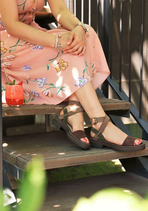 Closeup shot of elegant feet of a female wearing a dress at Summer royalty free stock photos