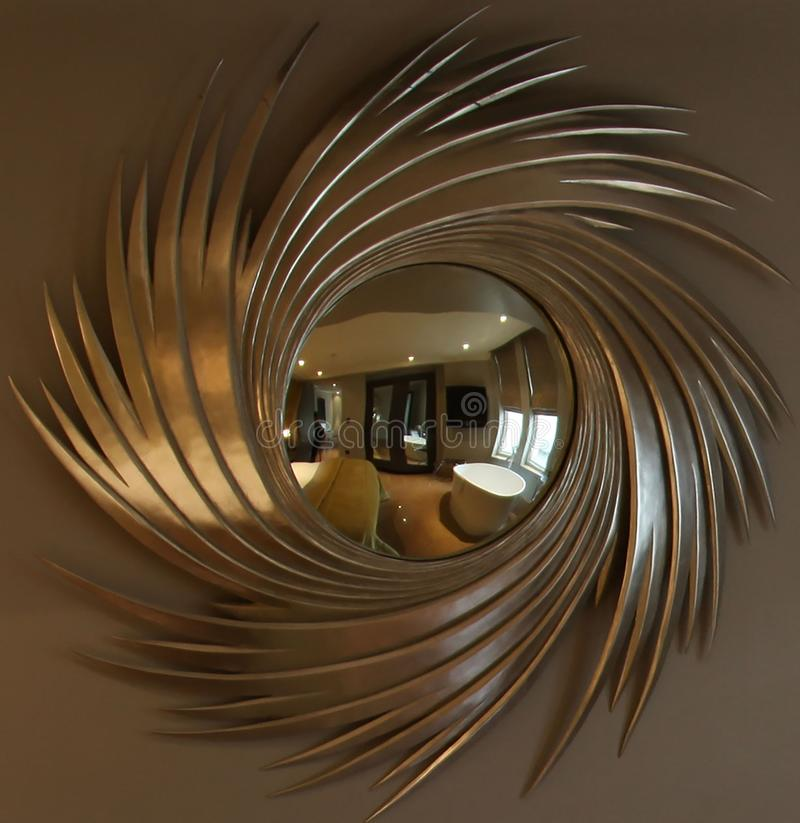 Closeup shot of an extravagant mirror reflecting the inside of a hotel room. A closeup shot of an extravagant mirror reflecting the inside of a hotel room royalty free stock images