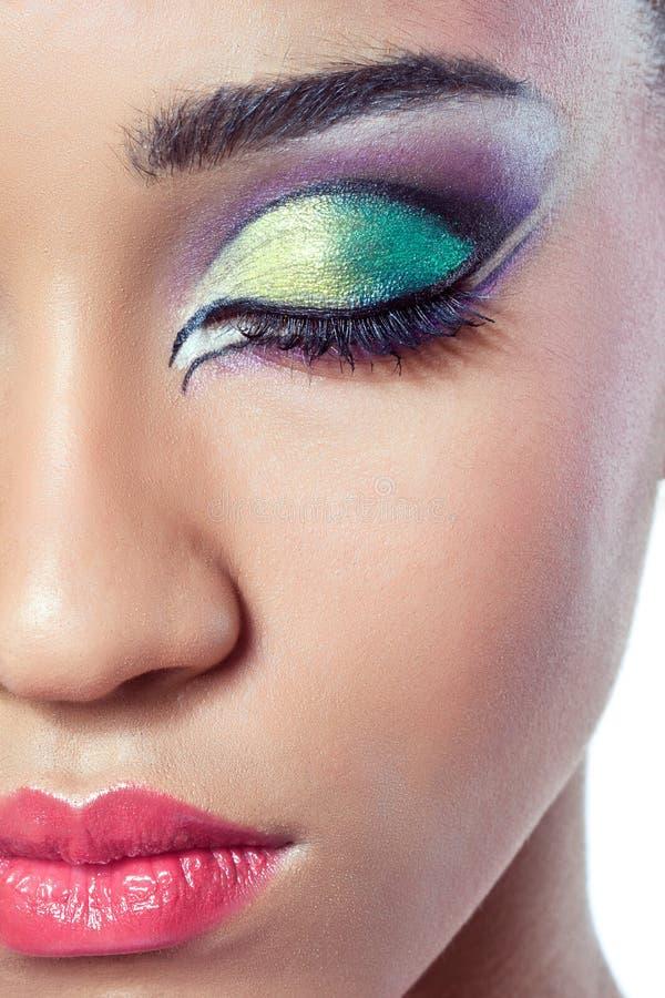 Closeup shot of a female face with colorful makeup stock photos