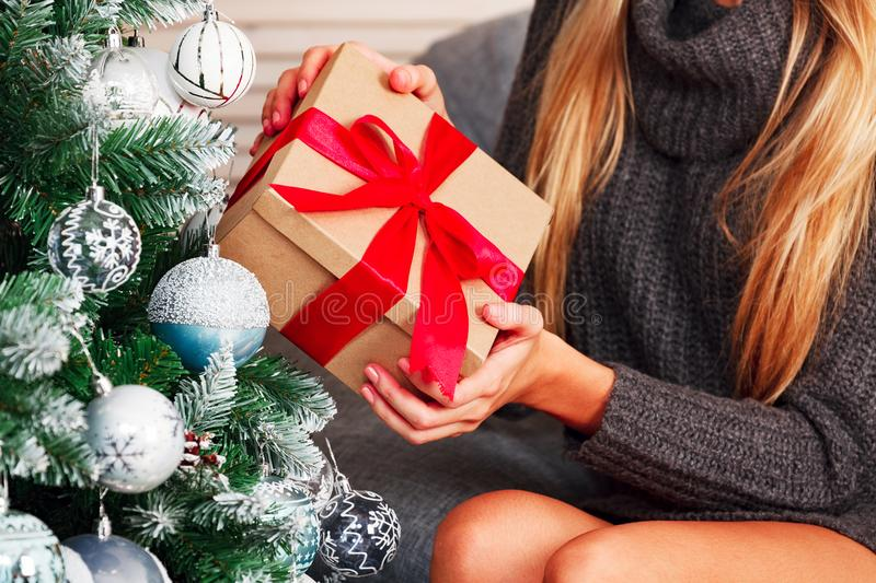 Closeup shot of female hands holding big gift box. stock images