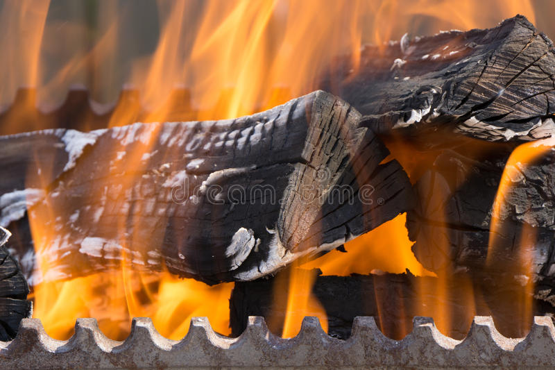 Closeup shot of fire wood coil in bbq royalty free stock image