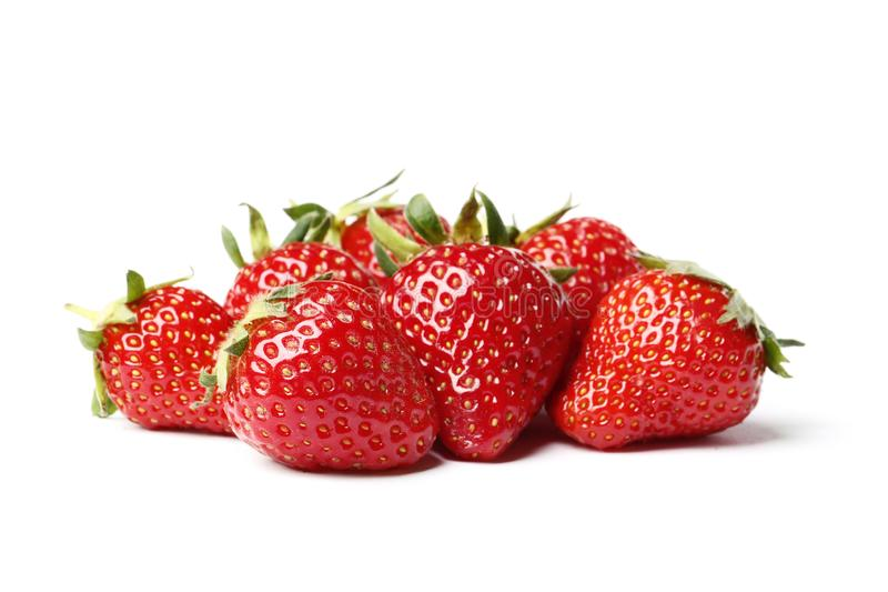 Closeup shot of fresh strawberries. Isolated on white background. Nature, summer, dessert stock image