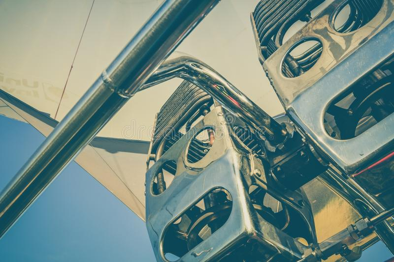 Closeup shot of hot air balloon engine under the beautiful blue sky royalty free stock photography