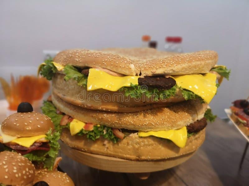 Closeup shot of a large cheeseburger royalty free stock photo