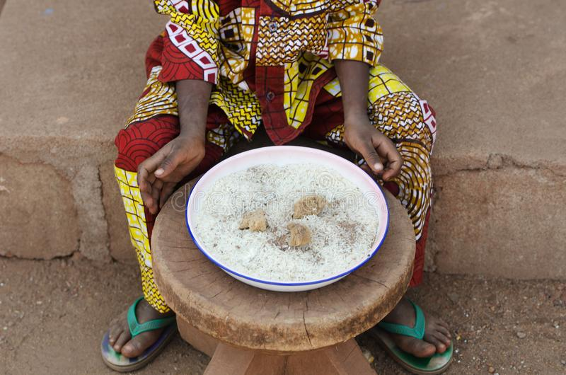 Closeup Shot of Little African Baby Eating Rice royalty free stock images