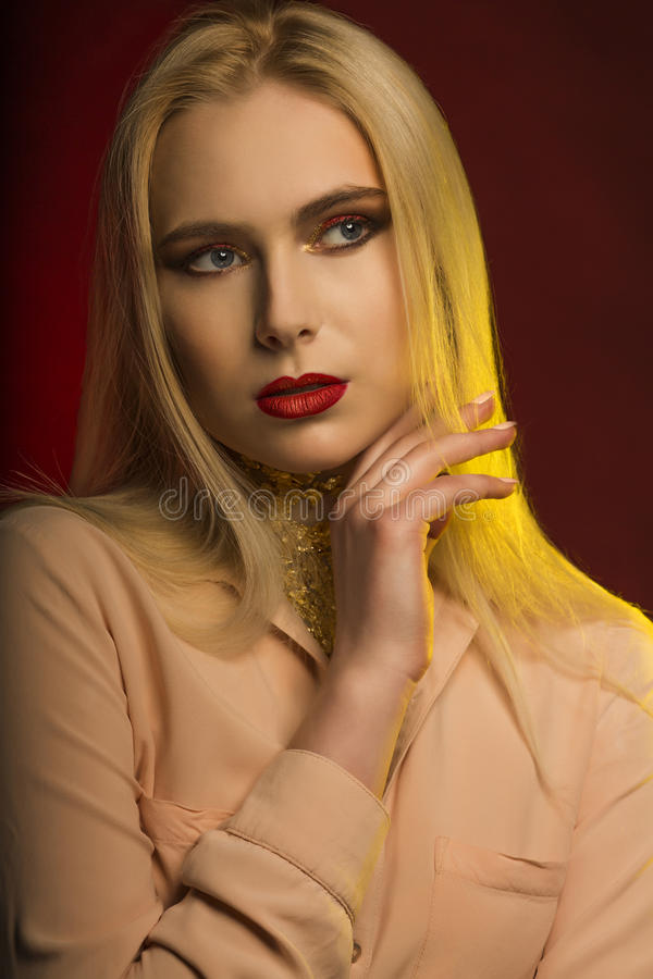 Closeup shot of luxury model with bright makeup and golden foil. royalty free stock photos