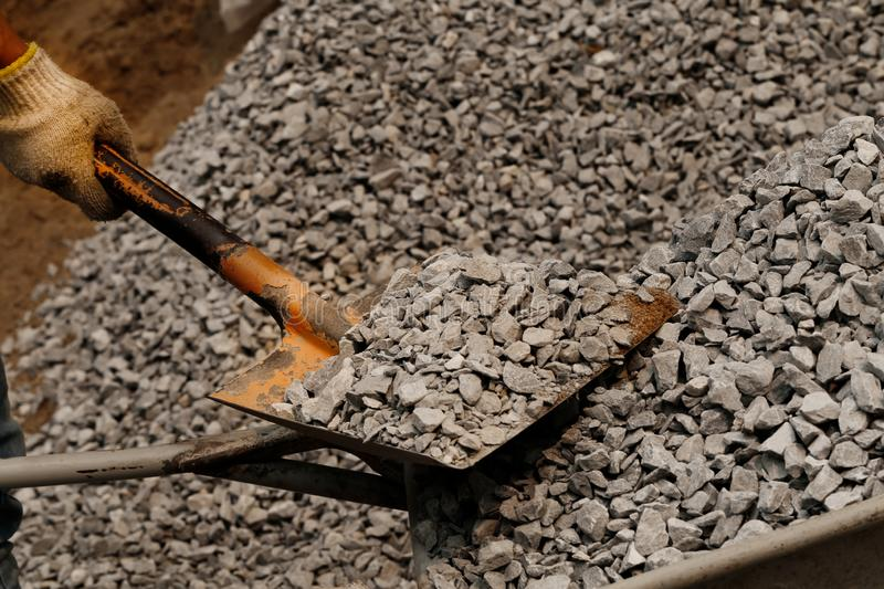 Closeup shot of man hand holding shovel and natural black charcoal for background. Picture idea about coal mining, coal processing stock photo