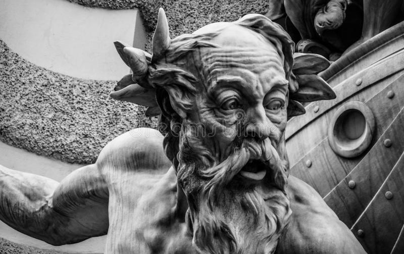 Closeup shot of an old man statue in black and white stock photo