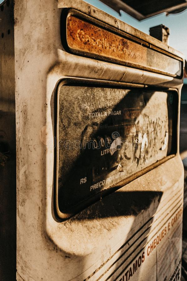 Closeup shot of an old worn-out rusty gas pump in Brazil, during daytime royalty free stock photo
