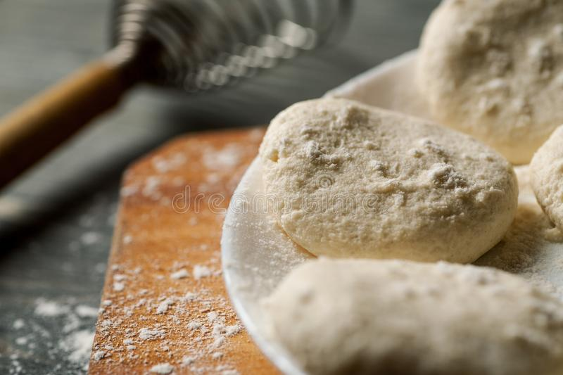 Closeup shot of raw homemade floured cheesecakes royalty free stock photo