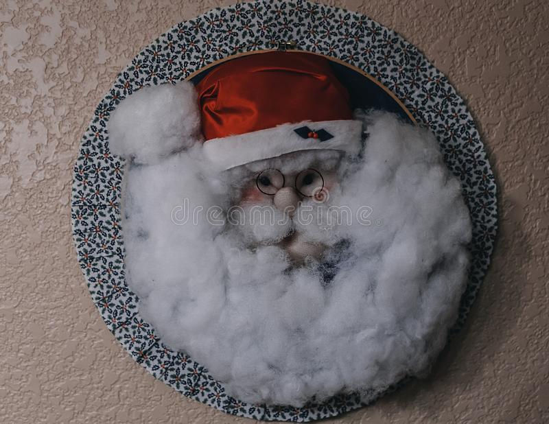 Closeup shot of a Santa Claus decor on a wall. A closeup shot of a Santa Claus decor on a wall royalty free stock photography