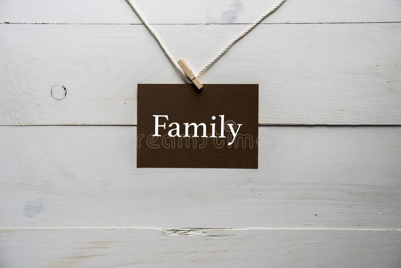 Closeup shot of a sing attached to a string with family written on it stock photos