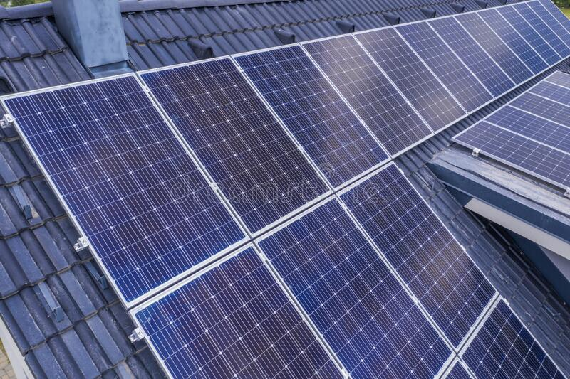 Closeup shot of solar panels installed on the roof of a house royalty free stock image