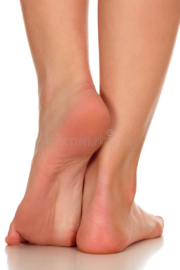 Closeup shot of tanned female feet stock images