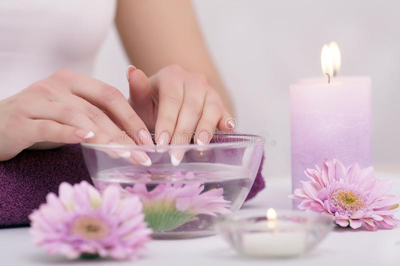 Closeup shot of a woman in a nail salon receiving a manicure by royalty free stock photos