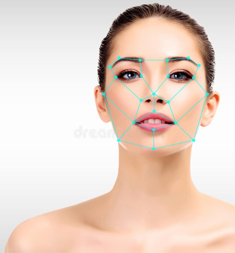 Closeup shot of woman with scnanning grid on the face. royalty free stock photography