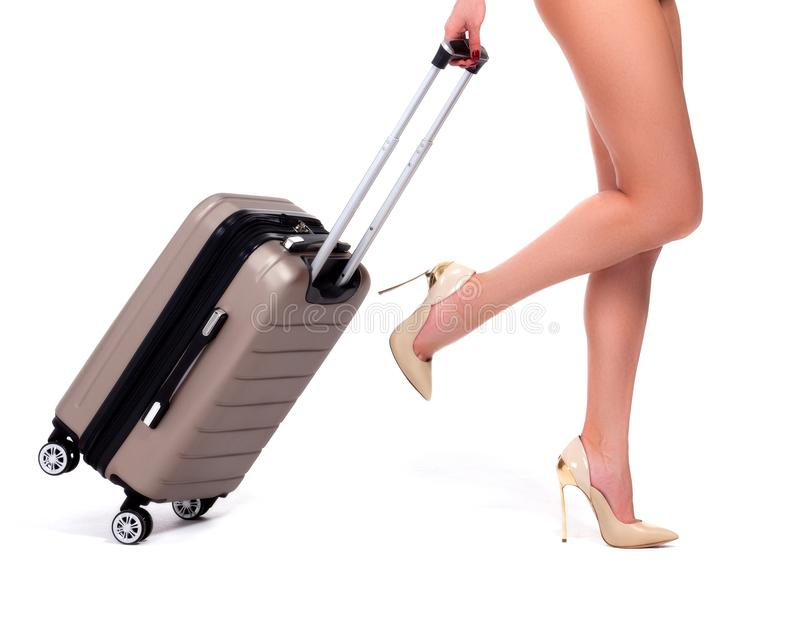 Closeup shot of woman who is pulling a suitcase royalty free stock photo