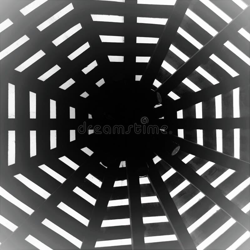 Closeup shot of wooden sticks forming a circle creating a visual illusion royalty free stock photos