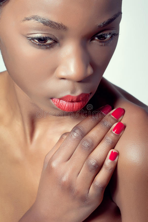 Closeup shot of a young woman with red lips stock image