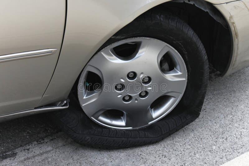 Car with flat shredded tire stock photos