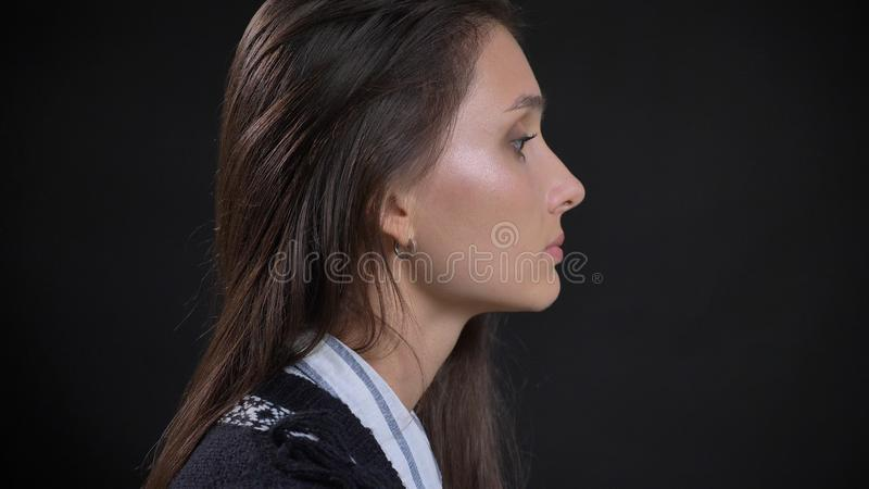 Closeup side view portrait of young cute caucasian female face with brunette hair looking forward with isolated royalty free stock photos