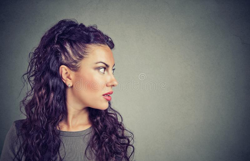 Closeup side view profile portrait woman talking with open mouth stock image