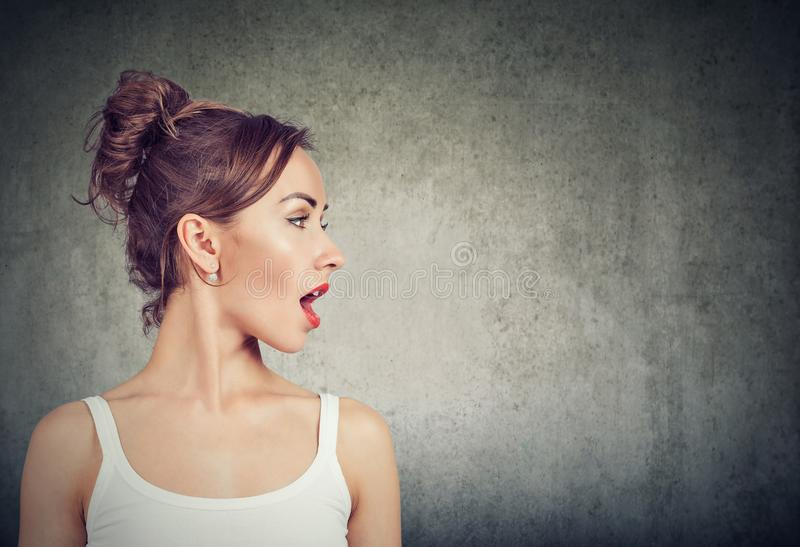 Closeup side view profile portrait woman talking with open mouth royalty free stock photos
