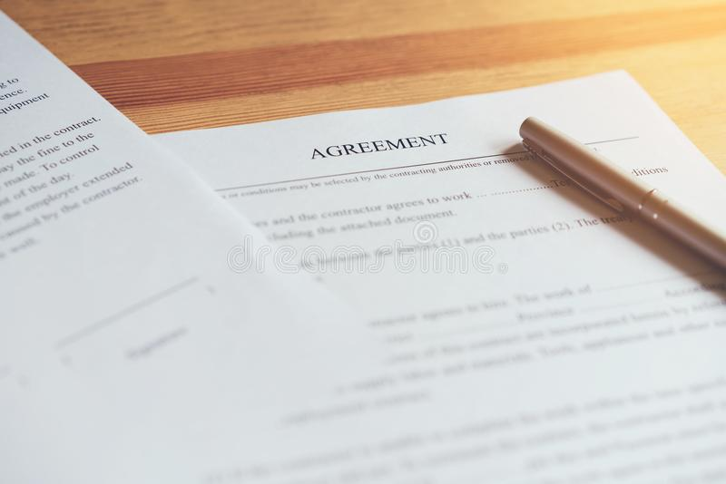 Closeup of signing a documentation agreement and pen on the table. Closeup of signing a documentation agreement and pen on the table royalty free stock photography