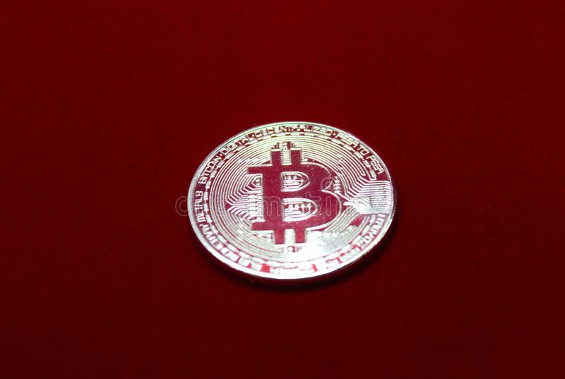bitcoin on red velvet background stock photos