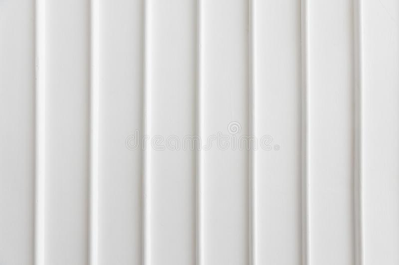 Closeup of simplicity white wall with vertical line pattern panel background texture stock photos