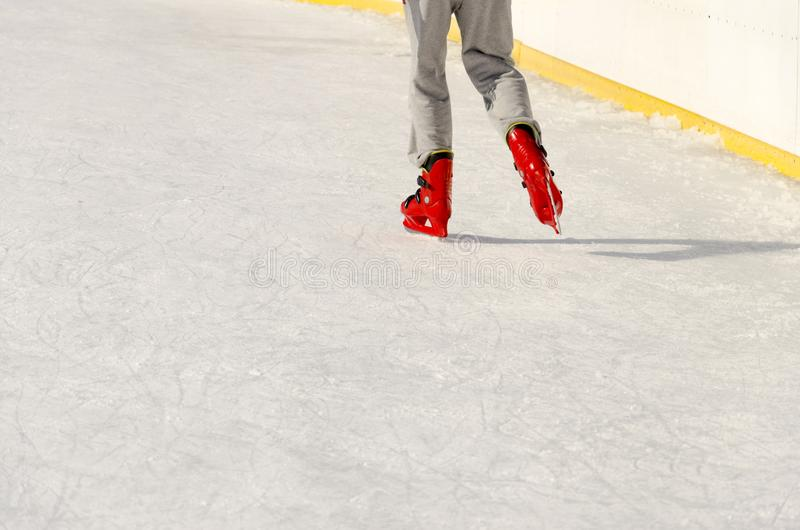 Closeup skating shoes ice skating outdoor at ice rink. Healthy lifestyle and winter sport concept at sports stadium stock photos