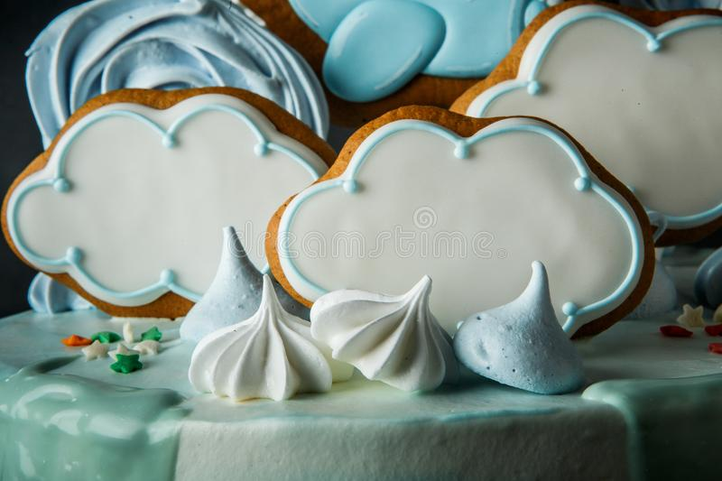 Closeup sky theme decoration of birthday cake. Closeup cloud-shaped gingerbread, zephyr and bizet as birthday cake decoration on sky theme stock images