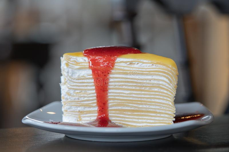 Slice Strawberry cheesecake layer cake Dessert Food on a white plate in the cafe focus blur background. Closeup Slice Strawberry cheesecake layer cake Dessert royalty free stock images