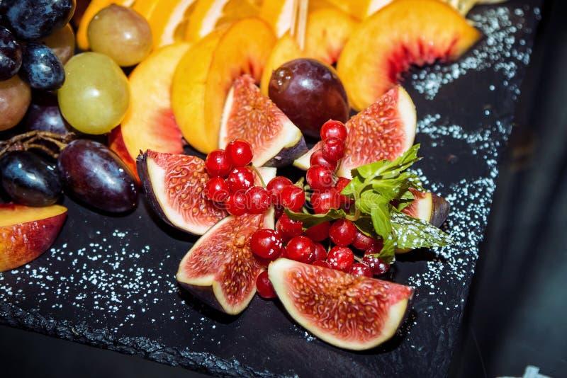 Closeup sliced fruits arrangement royalty free stock photos
