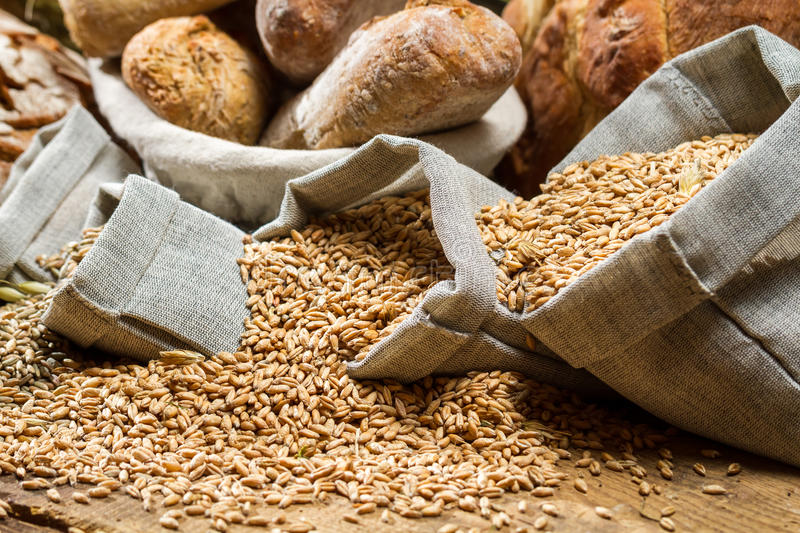 Closeup of small bags of cereal grains stock photo