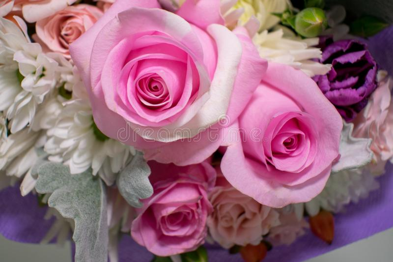 Closeup of a small bouquet with miniature pink roses royalty free stock image