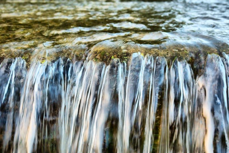 Closeup of small river waterfall stock image