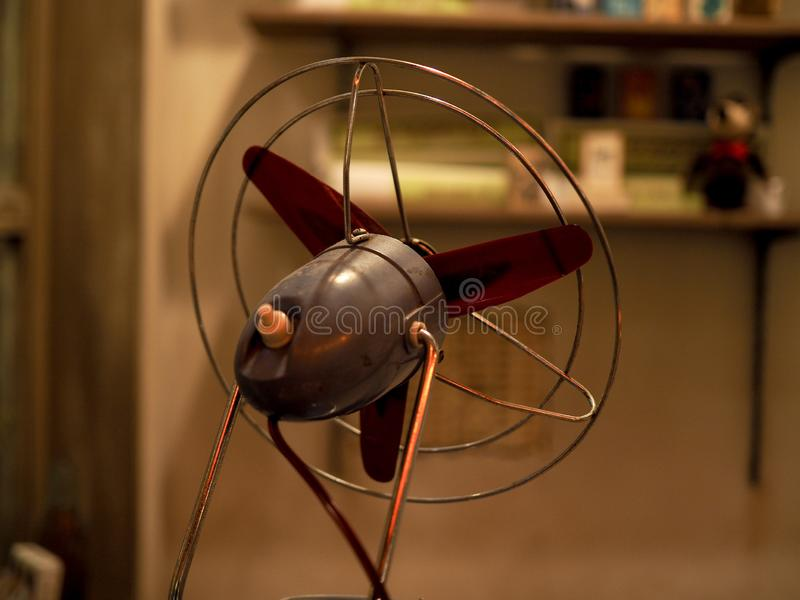 Closeup of small size classic fan from behind. stock photo